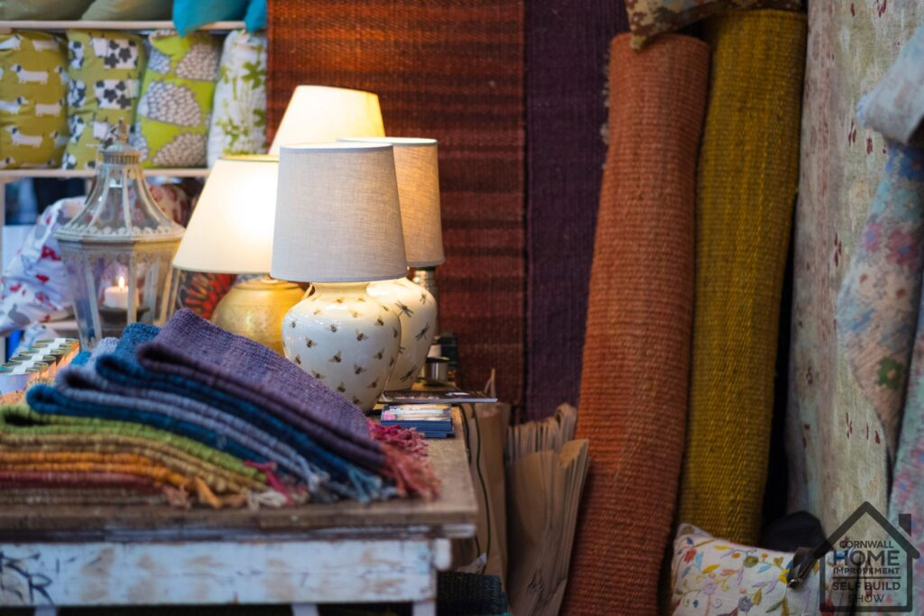 Beautiful interior inspiration with lamps, rugs, pillows at Cornwall Home Improvement & Self Build Show