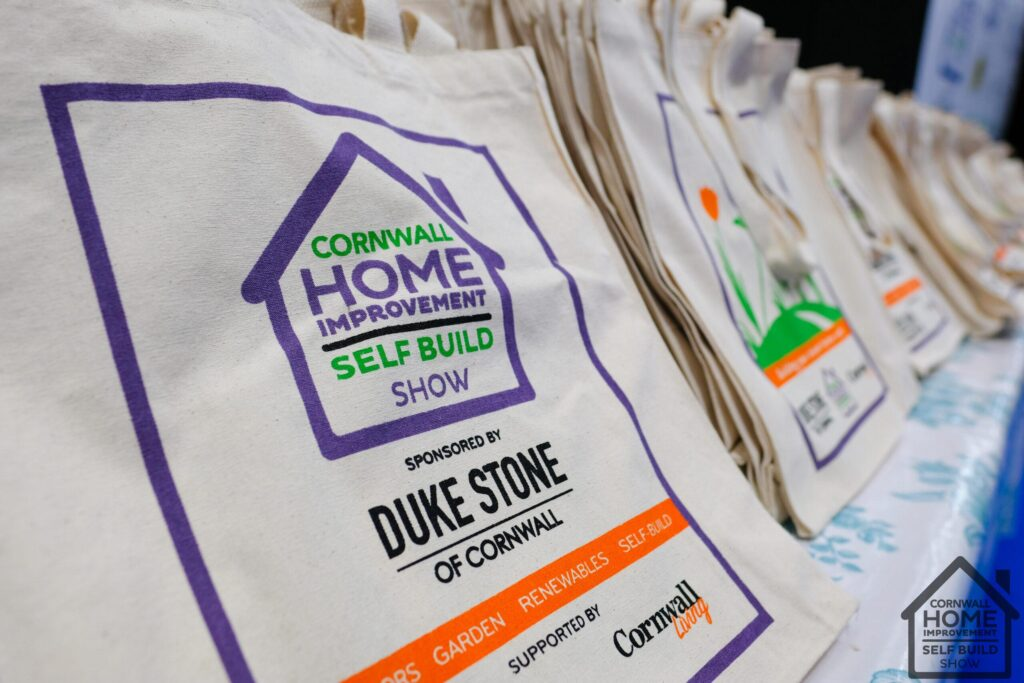 Branded bags with Cornwall Home Improvement & Self Build Show sponsors printed on the front