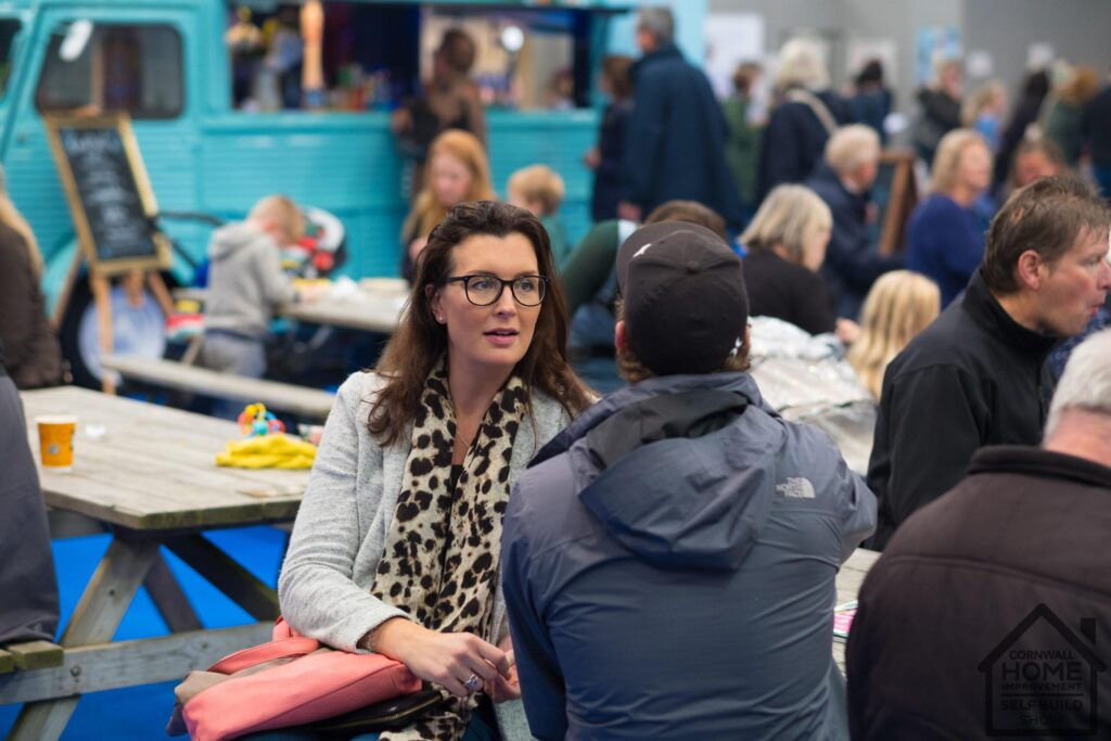 Happy and engaged visitors networking at Cornwall Home Improvement & Self Build Show
