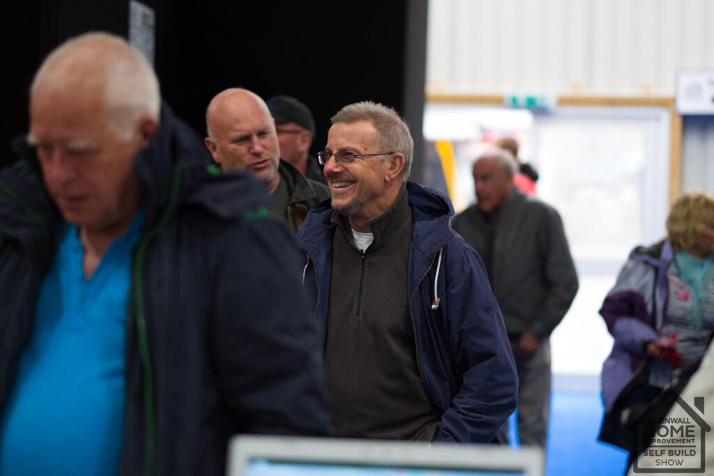 Happy visitors queueing to get into Cornwall Home Improvement & Self Build Show