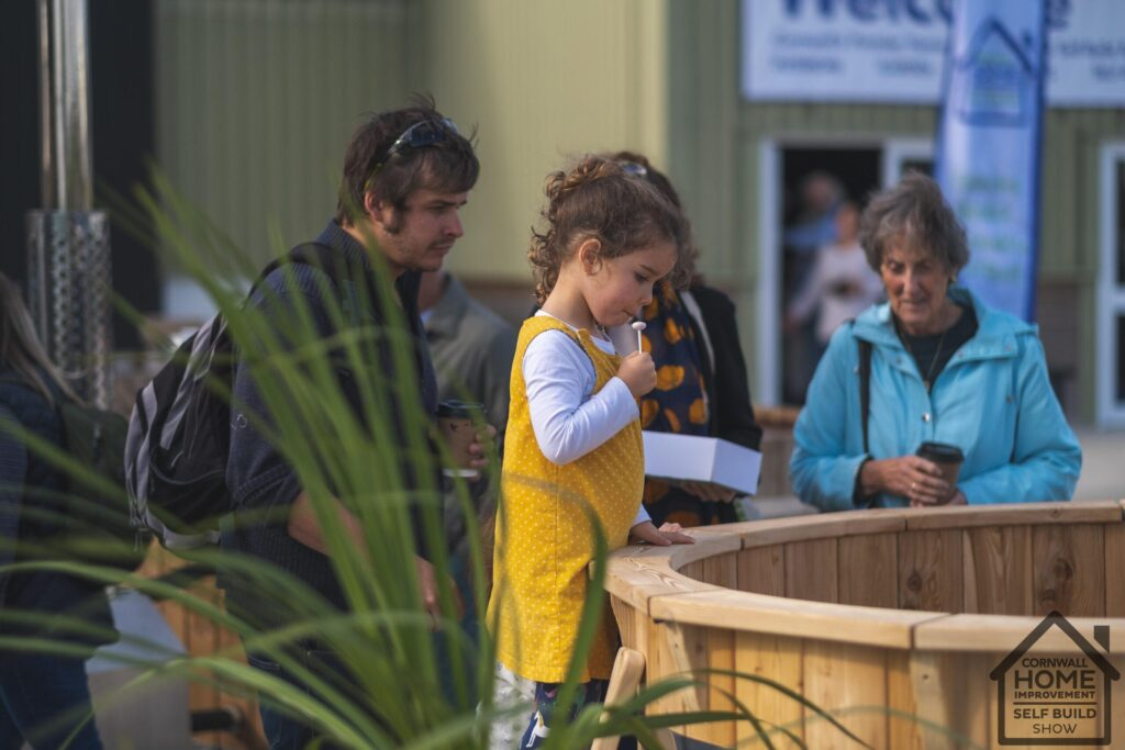 Child and family looking at hot tub solutions at Cornwall Home Improvement & Self Build Show