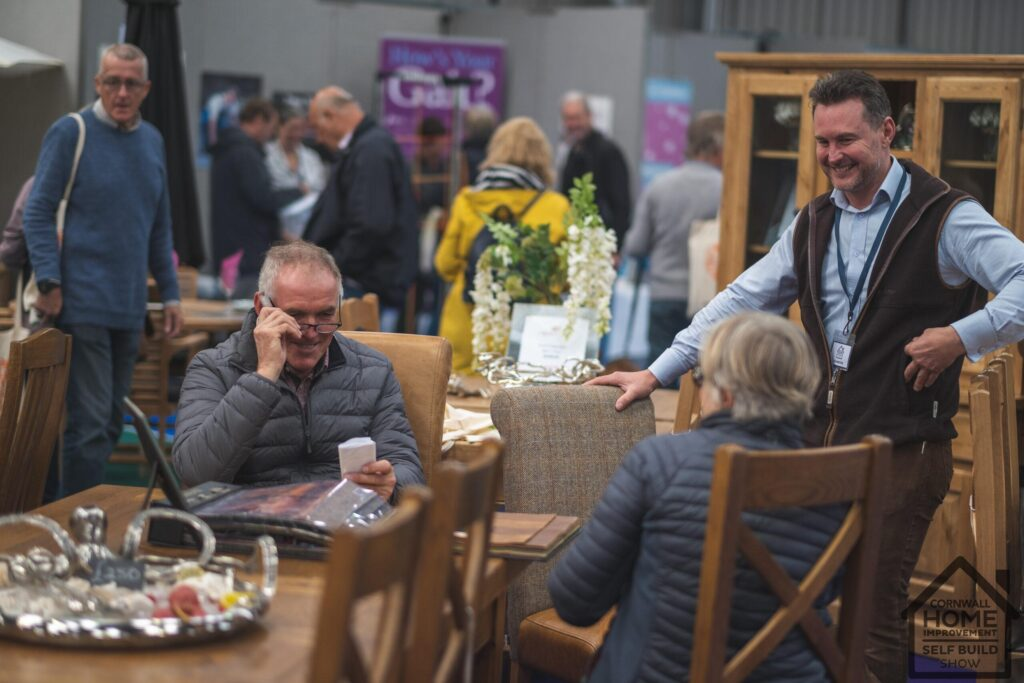Cornwall Home Improvement & Self Build Show visitors sampling furniture for their dream home
