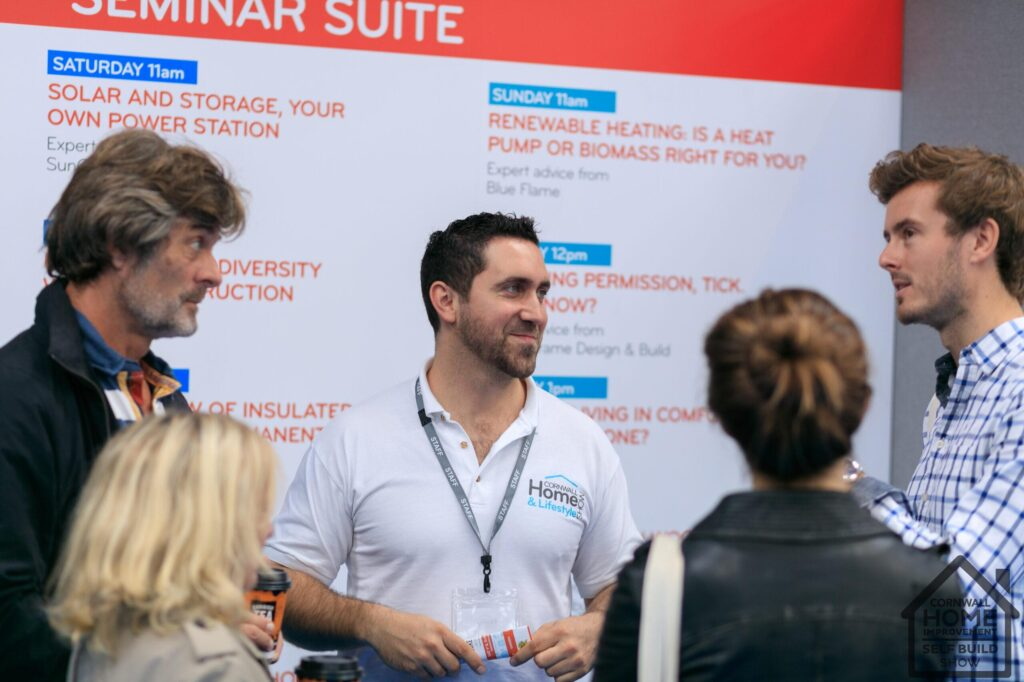 Expert seminar speakers talking in a group with home show staff