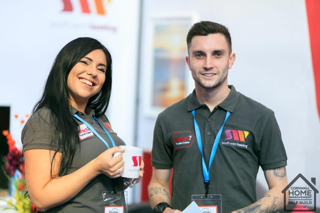 Two smiling empolyees for South West Heating