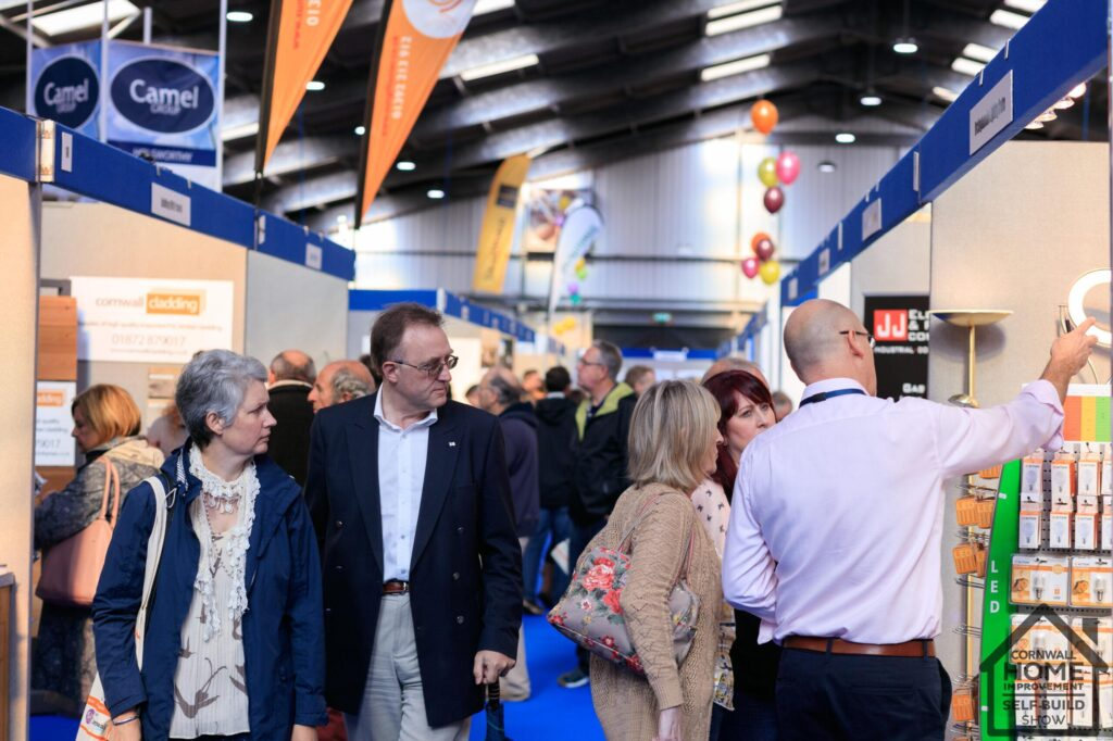 A busy home show, exhibitors explaining their services